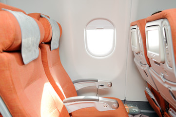 orange seats in airplane