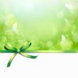 Grüne Schleife mit Schmetterlingshintergrund
