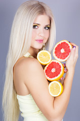 Beautiful blonde girl with fruits