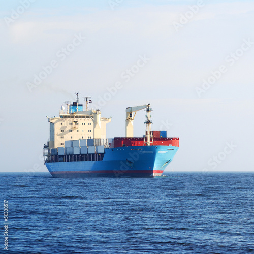 cargo conteiner ship sailing in still water