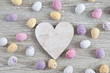Wooden heart with easter eggs