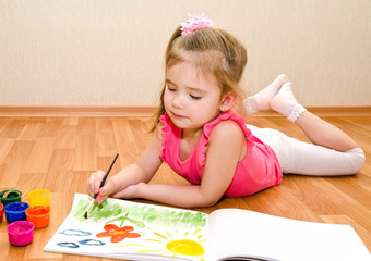 Little girl drawing with paint