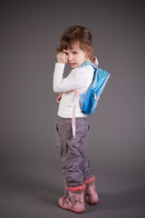 little girl with a backpack