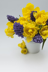 Beautiful spring bouquet of hyacinths and yellow tulips.