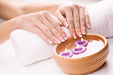 beautiful female hands with aromatic candles and towel. Spa - 50342923