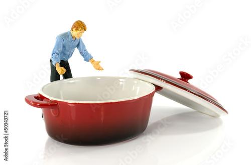 puppet looking in empty saucepan