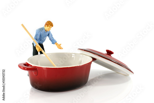 puppet man stirring in empty saucepan