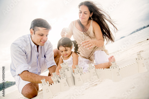 Family building sand castles