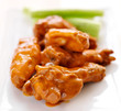 plate of buffalo wings with celery.