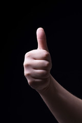 Thumb up on black background