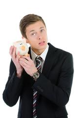 kaufmann horcht am sparschwein
