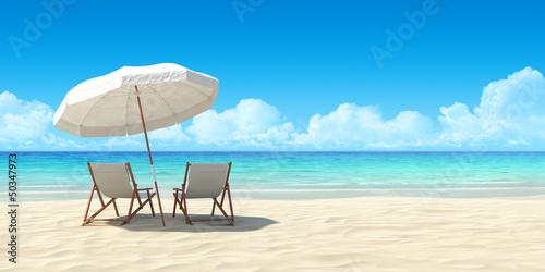 canvas print picture Chaise lounge and umbrella on sand beach.