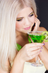 Sexy blonde gorl with green cocktail