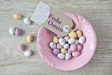 "Tag with ""Frohe Ostern"" and colorful eggs"