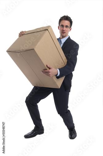 Geschäftsmann mit einer großen Box in der Hand
