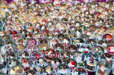 Various Christmas snow globe on a stall