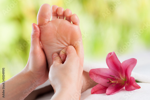 Hands doing foot reflexology.