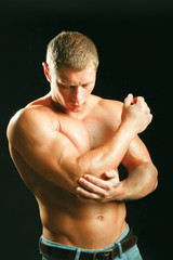 young man having pain in his elbow