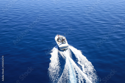 Motor boat or yacht on the lake Tahoe. Bird eye view.