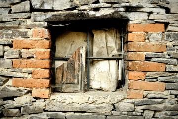 Old devastated window in stonewall