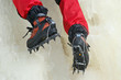 Ice climbing crampons in use closeup