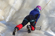 Female ice climber in icy mount