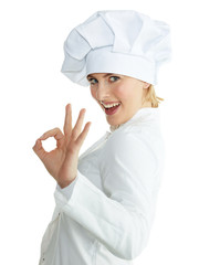 Female chef baker or cook shows ok