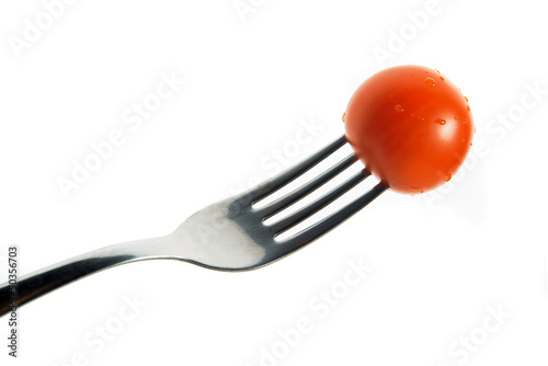 Cherry tomato on fork