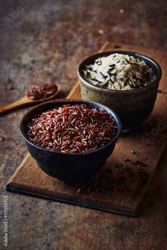 Different types of rice in ceramic bowls