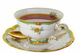 Fototapety Tea in an antique tea cup.