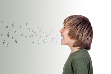 Adorable preteen with many letters out of his mouth