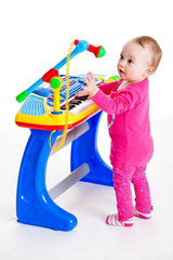 little girl and the keyboard on white background.