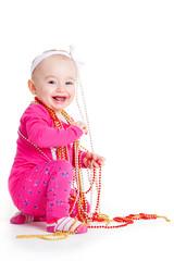 baby girl playing with beads. beautiful baby girl.