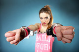 teen crime - teenager girl in handcuffs blue background