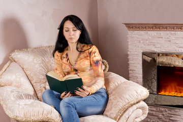 Woman reading in front of the fire