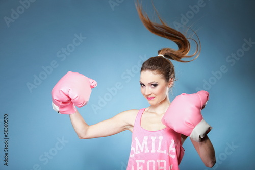 Female boxer model with big fun pink gloves