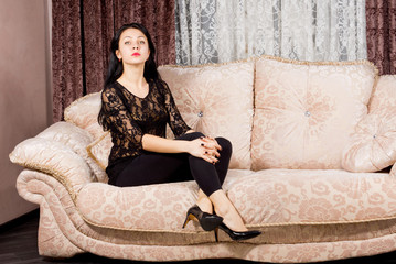 Sophisticated woman posing on a sofa