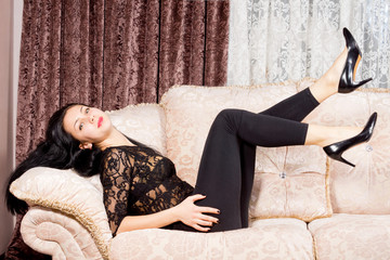 Stylish woman relaxing on a sofa