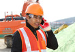 road construction worker communication with mobile phone