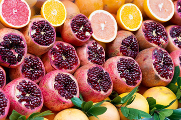 Fresh pomegranate, grapefruit and orange fruits