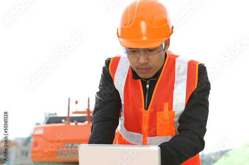road construction worker with  laptop