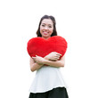 Women holding big love heart shape pillow isolated on white back