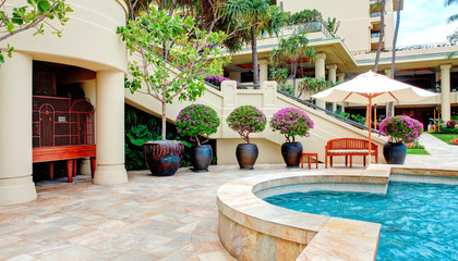 Tropical pool with luxury resort court yard.