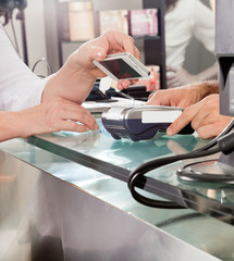 Customer Paying With Mobilephone Using NFC