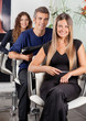 Confident Team Of Hairdressers At Salon