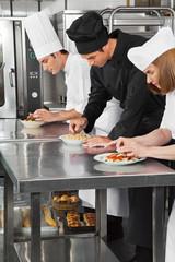 Chefs Garnishing Pasta Dishes