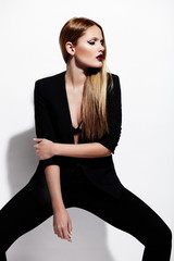 sexy stylish model in black cloth with bright makeup