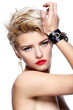 sexy blond model with red lips,bright makeup, with short hair