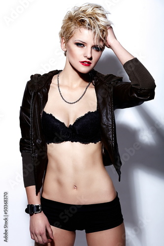 glamor sexy stylish blond model in black cloth with short hair