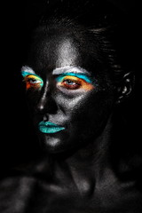 art photo of model with creative black mask face